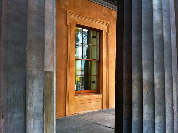 window at the museum between columns