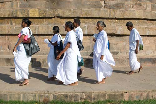 Pilgrims Walking Around The Stupa At Sarnath