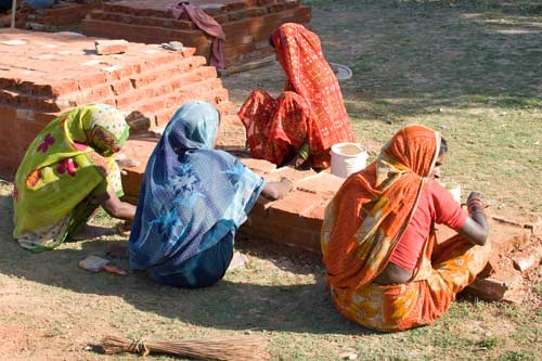 Women Rebuilding Walls At Sarnath