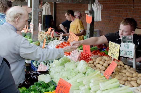 A Customer Getting Change From A Stallholder In Kirkgate Market - Leed