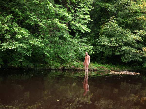 Antony Gormley sculpture of a naked man standing in the river at the back of the Scottish National Gallery of Modern Art