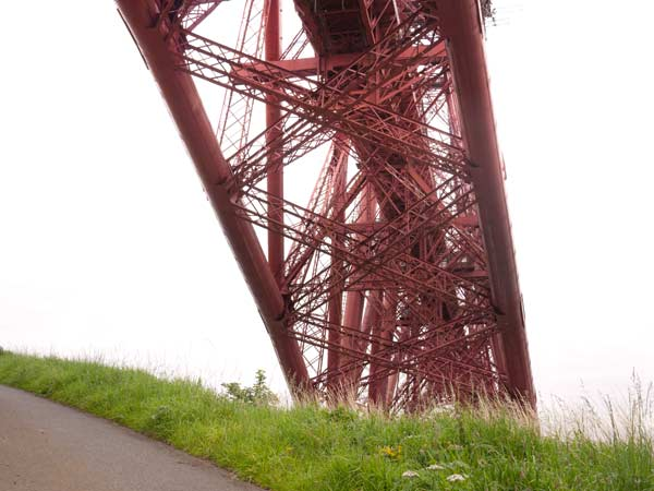 photo of the forth rail bridge from beneath at waters edge on the north queensferry side