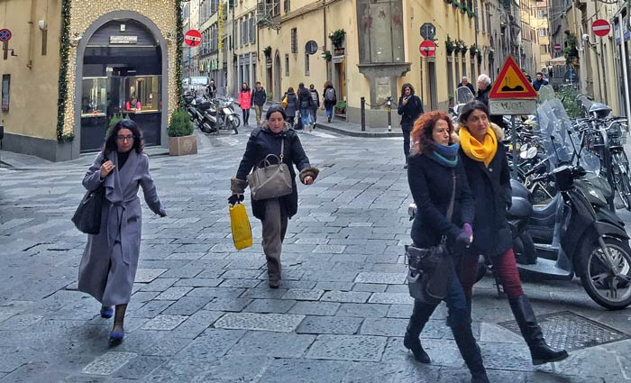 women on their way to work in Florence