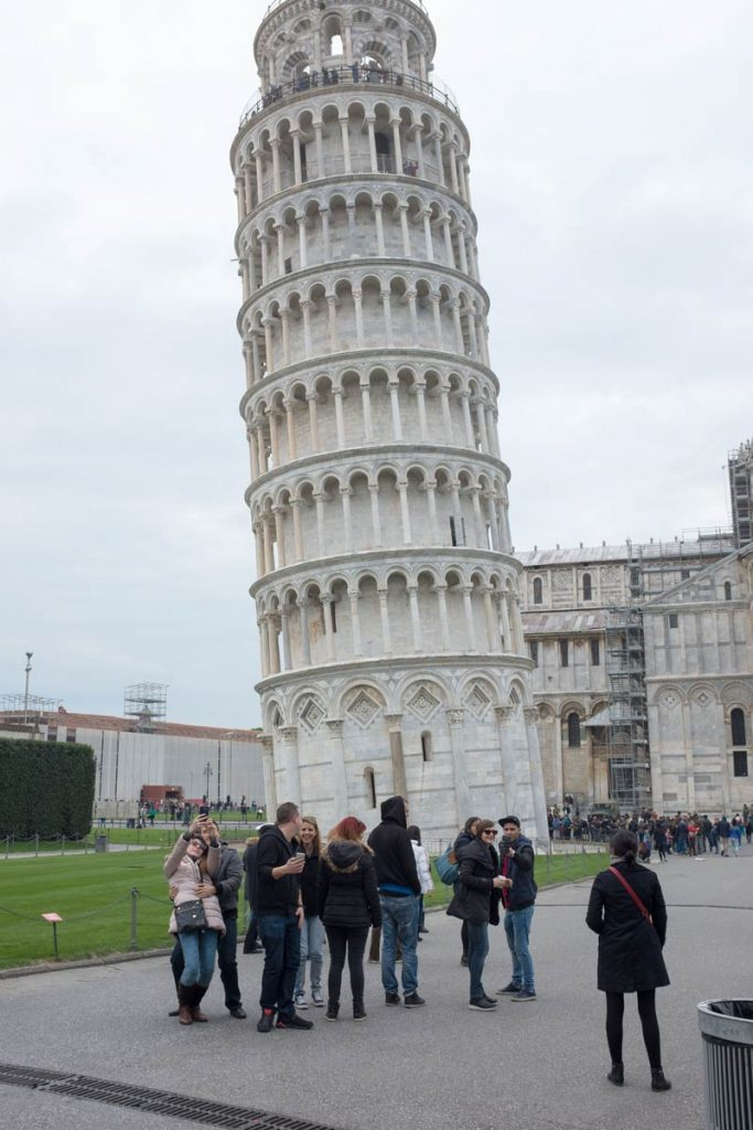 the leaning tower of pisa with people standing near it