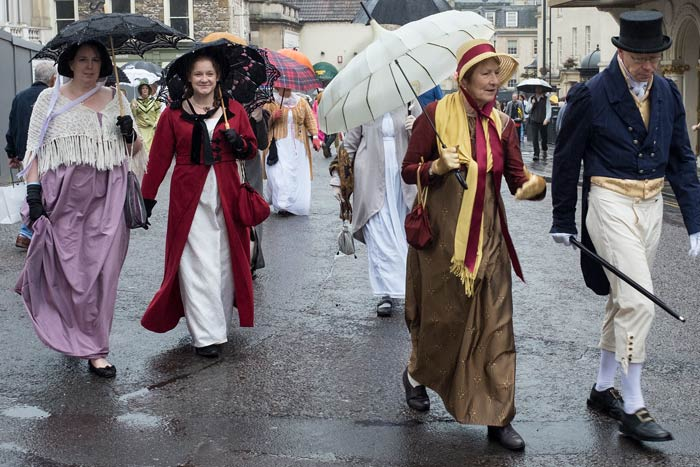 Procession of people in period costume at the Jane Austen Festival in Bath