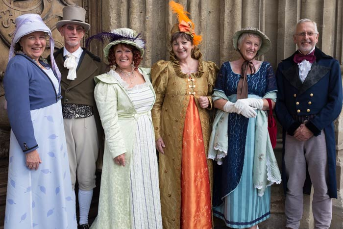 People in period costume at Bath Abbey during the Jane Austen Festival in Bath