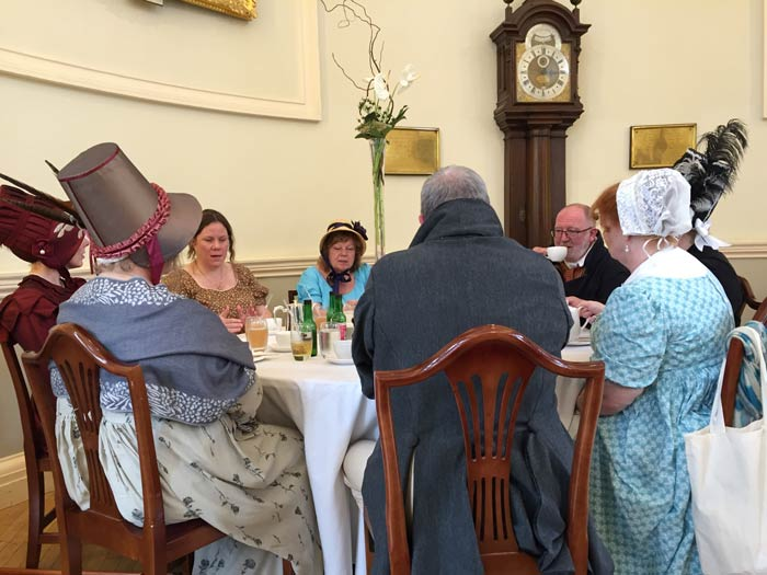People-in-Regency-costume-taking-tea-in-the-Pump-Room-in-Bath