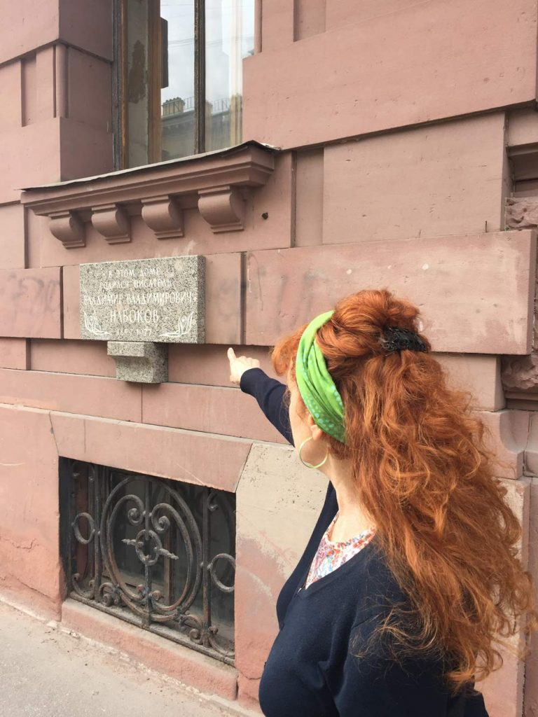 Tamara pointing at the plaque on the wall of Nabakov's house